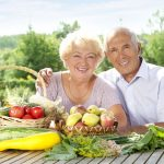 Happy elderly couple with this year's rich harvest
